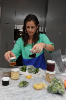 Sweet Roots NYC customer Carolyn Lanzetta unpacks two ready-to-cook.